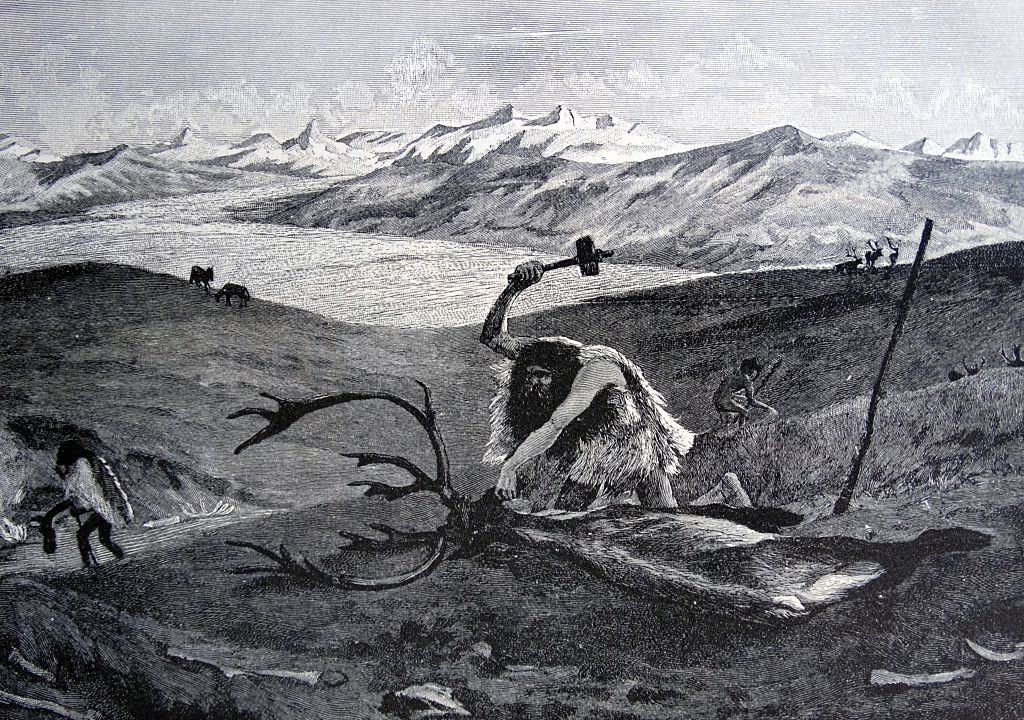 A painting depicts a hunter during the Ice Age using a blunt instrument to take down a reindeer