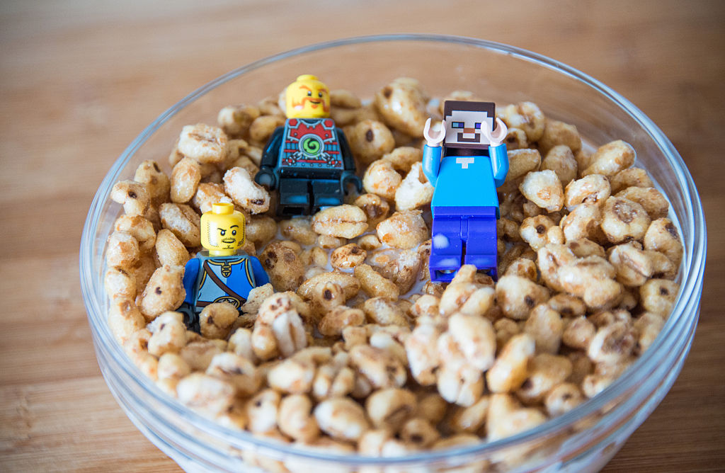 a bowl of cereal with lego minecraft toys inside