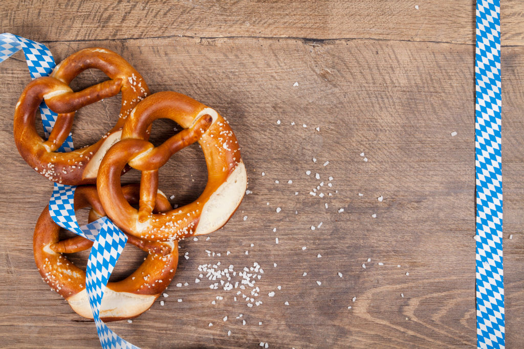 3 pretzels on a wooden table with some ribbon
