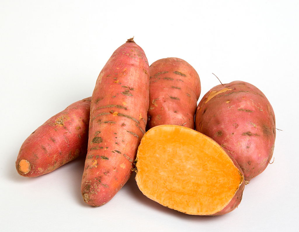 4 and a half sweet potatoes against a white background