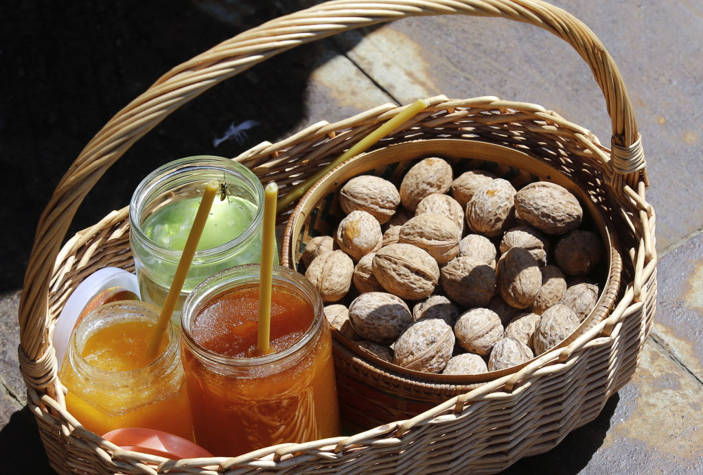 a basket with honey and walnuts