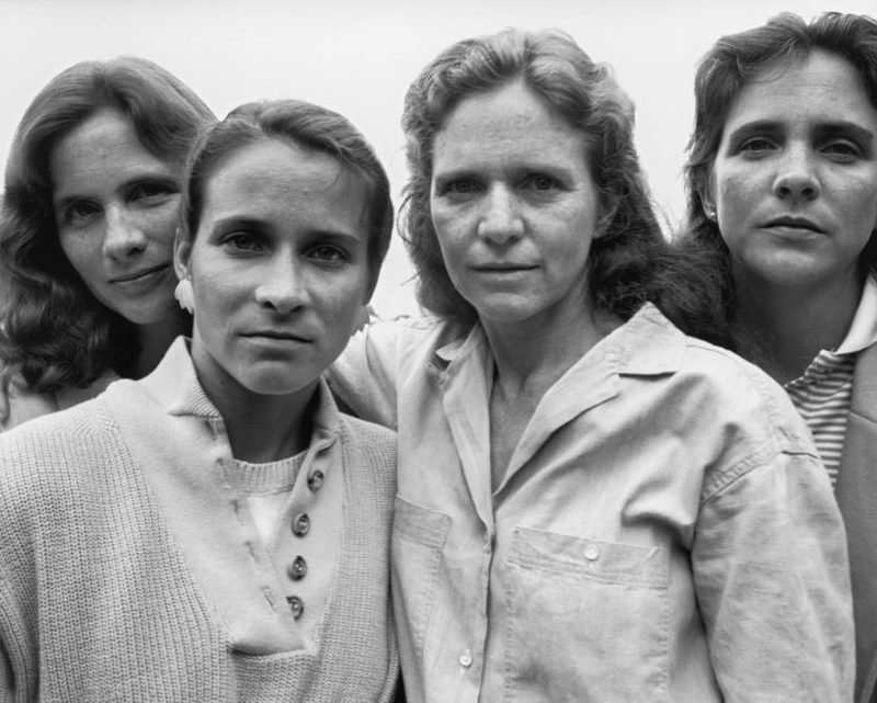 four sisters in a family photo