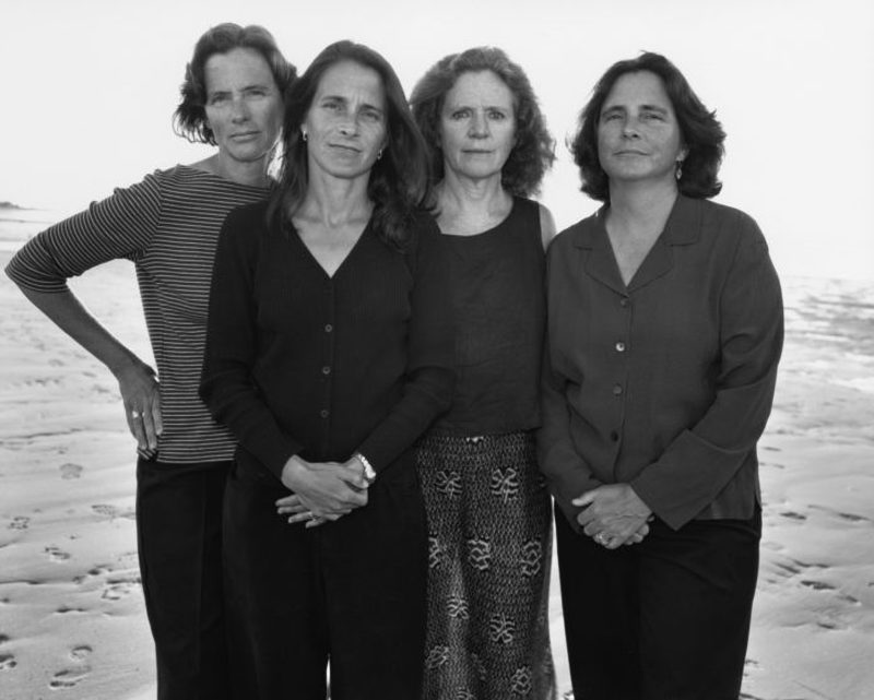 four sisters posed together
