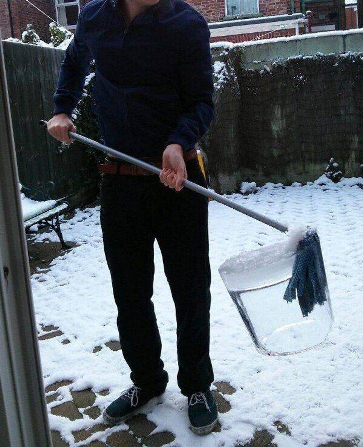 mop encased in solid chunk of ice