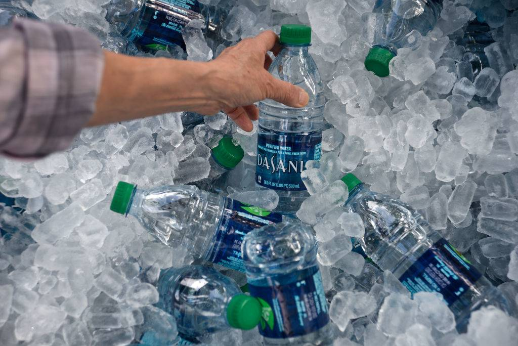 A tub filled with ice and plastic bottles of Dasani purified bottled water