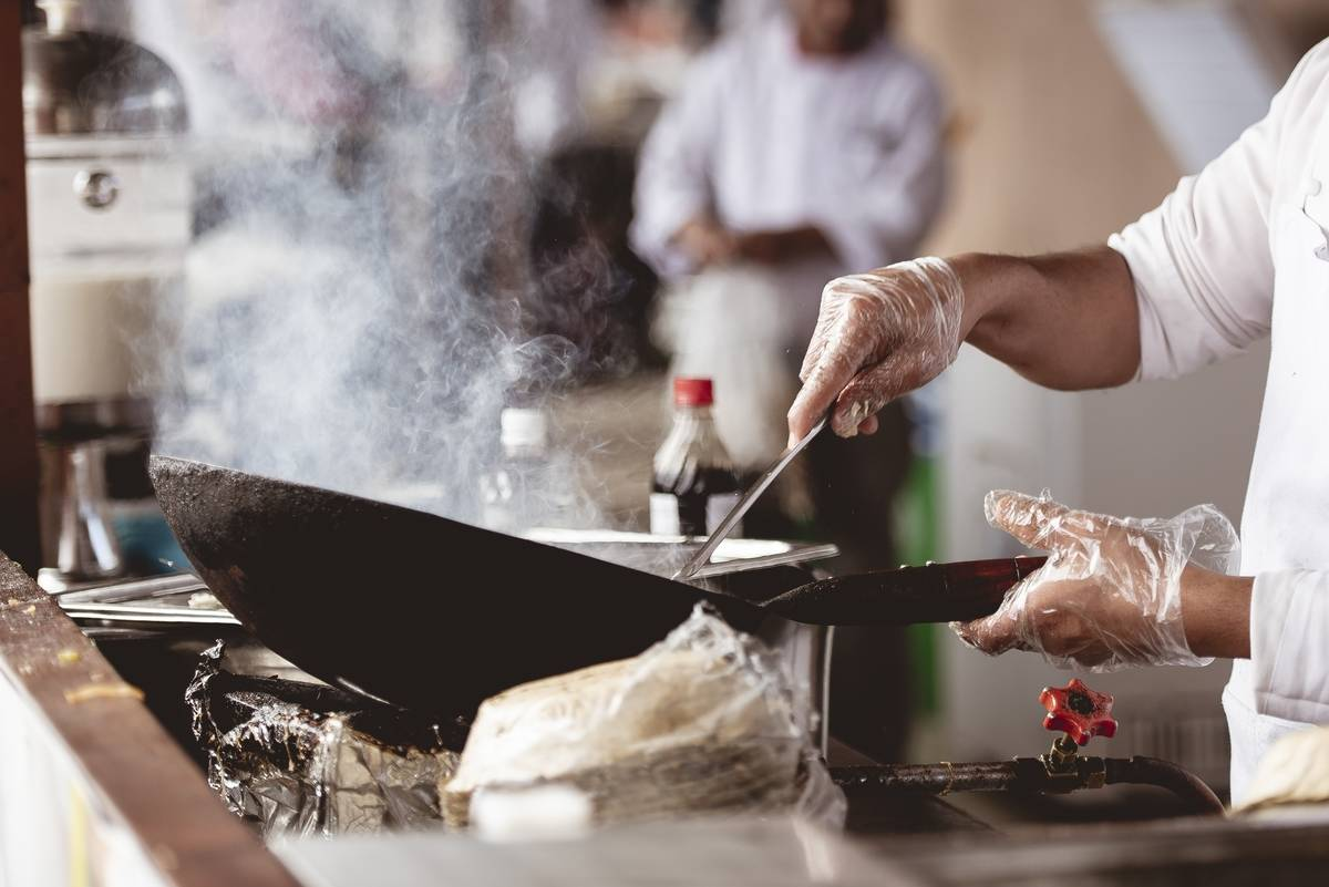 closeup-shot-of-a-chef-cooking-with-a-blurred-background